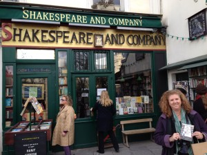 CD at the Shakespeare and Co. bookstore holding my copy of The Library of Unrequited Love, which I had just purchased.