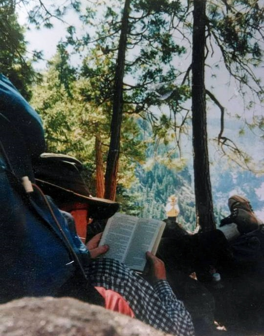 George reading backpacking