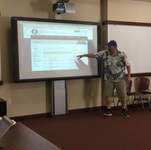 Bishop's School teacher presenting on the Global Economy.