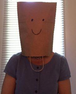 Maggie w bag on head